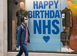 © Licensed to London News Pictures. 24/07/2020. London, UK. A shopper wearing a mask outside Primark on Oxford Street in central London, on the day that the wearing of mask in shops becomes compulsory. The UK Government has published formal guidance on spaces where the wearing of masks will now be mandatory, including in shops, supermarkets and shopping centres. Photo credit: Ben Cawthra/LNP