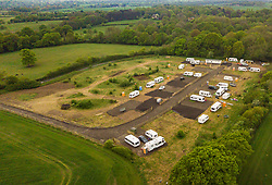 An aerial view of the Travelers' camp on land that they purchased but have not received planning permission from the local authority for permanent structures. Little Hadham, Herts, May 03 2019.