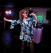 Model singing karaoke for an editorial feature.