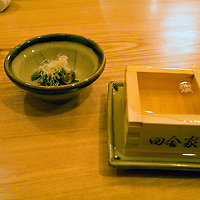 Asia, Japan, Tokyo. Sake poured to overflowing in a wooden box as served at Inakaya Ginza in Tokyo.
