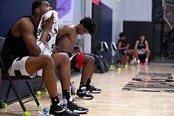 G League Ignite's Michael Foster, left, and his teammates take a break between drills during a practice with the team on Tuesday, Sept. 28, 2021 in Walnut Creek, Calif.