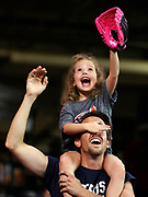 A young fan on the shoulders of another fan reaches for a ball during the game between the Houston Astros and the Oakland Athletics on September 12, 2019 at Minute Maid Park in Houston, Texas. (Photo by Katelyn Mulcahy)