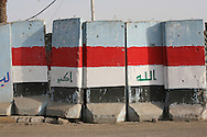 Iraqi flag on theThe Golden Wall- a barrier made up T-walls encircling the southern part of Sadr City. It was put up a year ago to stop the flow of insurgents and weapons. The walled off part of Sadr City is home to some members of JAM (Jaysh al-Mahdi Militia) and Al Qaeda.