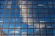 clouds in the sky reflected in the glass panels of the Northern & Shell Building. London.