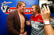 James Somerset from The Crowd Goes Wild exchanges tops with Crusaders player Thomas Waldrom during an interview. Super 14 rugby union. 2010 Rebel Sport Super 14 New Zealand squads naming press conference. Auckland, New Zealand. Wednesday 11 November 2009. © Copyright Photo: www.photosport.nz