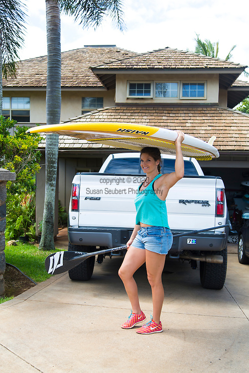 Olympic skier Julia Mancuso with her surf boards in her truck on the island of Maui, Hawaii