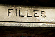 Sign for Filles showing French language influence, St Peter Port, Guernsey, Channel Islands, UK