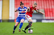 Reading defender Emma Mitchel (3) is tackled by Manchester United midfielder Leah Galton (11) during the FA Women's Super League match between Manchester United Women and Reading LFC at Leigh Sports Village, Leigh, United Kingdom on 7 February 2021.