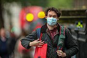 People some of them wearing face protective surgical masks, walk across central London on Sunday, Aug 8, 2021. Scientists are warning the public not to be complacent, saying high levels of infection in the community are likely to lead to another spike in cases this fall. (VX Photo/ Vudi Xhymshiti)