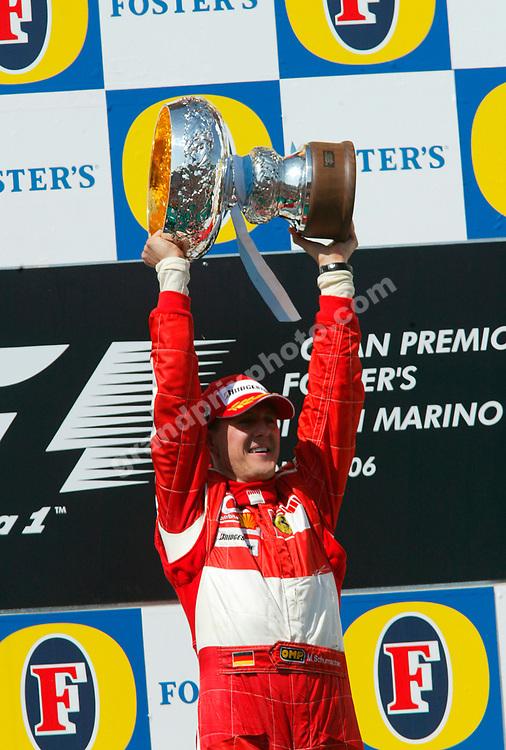 Michael Schumacher (Ferrari)  with the trophy on the podium after the 2006 San Marino Grand Prix in Imola. Photo: Grand prix Photo