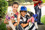 Young children with their pets dressed in patriotic costume during the annual I'On Community Independence Day Parade on July 4, 2012 in Mt Pleasant, South Carolina.