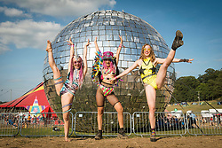 Festival goers performing in front of the giant glitter ball at Bestival 2018 Lulworth Castle - Wareham. Picture date: Saturday 4th August 2018. Photo credit should read: David Jensen/EMPICS Entertainment