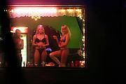 Dubi/Tschechische Republik, CZE, 14.12.06: Prostituierte bieten Ihre Dienste in einem Bordell an der E-55 in der Stadt Dubi (Eichwald) an - Dubi liegt etwa fünf Kilometer.nördlich von Teplice direkt an der E55. Einst ein respektierter Kurort, ist die Kleinstadt in den vergangenen 15 Jahren zu einem Eldorado des Sextourismus geworden. <br /> <br /> Dubi/Czech Republic, CZE, 14.12.06: Prostitutes offering their service in a brothel in Dubi at the E-55 highway. Dubi is located five kilometer north from the city of Teplice.