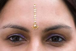 Woman wearing a forehead bindi,
