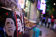 Street scene with the portrait of Barack Obama in Mao pose printed on a T-Shirt at a public square in the center of Beijing. Beijing is the capital of the People's Republic of China and one of the most populous cities in the world with a population of 19,612,368 as of 2010.