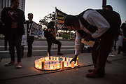 """Participants of """"Justice for Claudia and All kidnapped Indigenous children!"""" lights up their candle to demand justice for Claudia Patricia Gómez González in front of the United States Citizenship and Immigration building in Downtown Los Angeles, California on June 1st, 2018. (Photo by Yuki Iwamura)"""