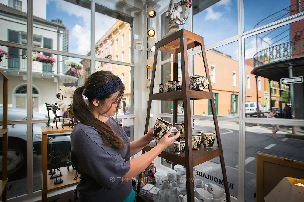 Amanda Villadsen looks at merchandise while shopping along Royal Street in the French Quarter in New Orleans, La.