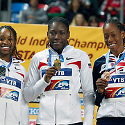 Brittney Reese (C) of the U.S., Janay DeLoach (L) of the U.S. and Shara Proctor of Britain display their medals during the awards ceremony for the women's long jump at the IAAF World Indoor Championships at the Atakoy Athletics Arena, Istanbul, Turkey. Photo by TURKPIX
