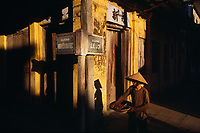 """The late afternoon sun paints shadows on the wall of a traditional shop house in the historic town of Hoi An, Vietnam.<br /> Available as Fine Art Print in the following sizes:<br /> 08""""x12""""US$   100.00<br /> 10""""x15""""US$ 150.00<br /> 12""""x18""""US$ 200.00<br /> 16""""x24""""US$ 300.00<br /> 20""""x30""""US$ 500.00"""
