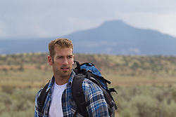 man hiking in Abiquiu, New Mexico