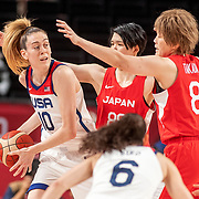 TOKYO, JAPAN August 8:  Breanna Stewart #10 of the United States defended by Maki Takada #8 of Japan and  Himawari Akaho #88 of Japan during the Japan V USA basketball final for women at the Saitama Super Arena during the Tokyo 2020 Summer Olympic Games on August 8, 2021 in Tokyo, Japan. (Photo by Tim Clayton/Corbis via Getty Images)