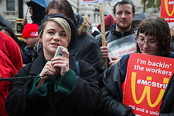 London, UK. 12 November, 2019. Jo Grady, General Secretary of the University and College Union (UCU), addresses McDonald's workers belonging to the Bakers Food & Allied Workers Union (BFAWU) assembled opposite Downing Street during strike action, dubbed a 'McStrike', to call for a New Deal for McDonald's Workers which would include £15 an hour, an end to youth rates, the choice of guaranteed hours of up to 40 hours a week, notice of shifts four weeks in advance and union recognition.