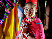 Portrait of a Kayah Red Karen ethnic minority woman on 18th January 2016 in Kayah State, Myanmar. Myanmar is one of the most ethnically diverse countries in Southeast Asia with 135 different indigenous ethnic groups with over a dozen ethnic Karenni subgroups in the Kayah region. Kayah women wear a simple black tunic worn with a broad white sash decorated with coloured tassles and a striped hand-woven head-cloth