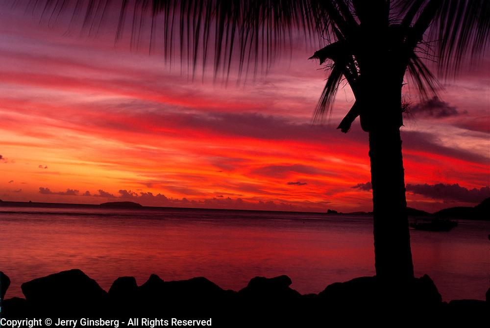 Brilliant sunset over the Caribbean at Cinnamon Bay, Vrgin Islands National Park, St. John, U. S. Virgin Islands
