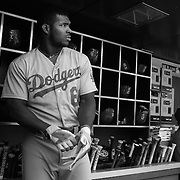 Yasiel Puig, Los Angeles Dodgers, prepares to bat in the dugout during the New York Mets Vs Los Angeles Dodgers MLB regular season baseball game at Citi Field, Queens, New York. USA. 26th July 2015. Photo Tim Clayton