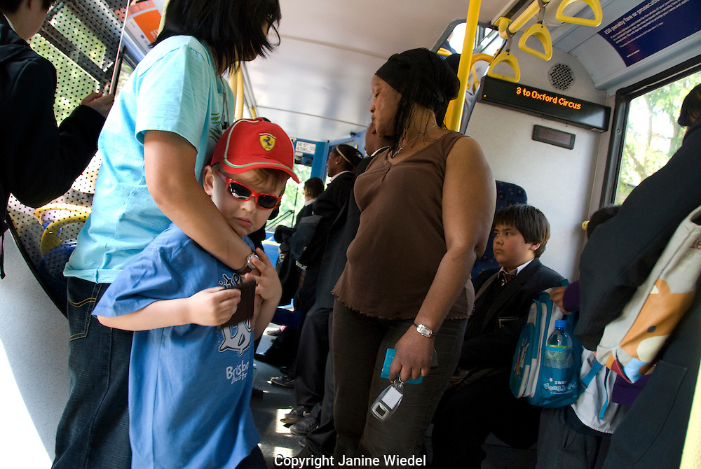 Mother and child travelling on bus
