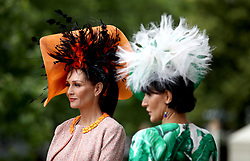 Chelsey Baker (left) and Ilda Di Vico from Surrey pose for photographers during day two of Royal Ascot at Ascot Racecourse.