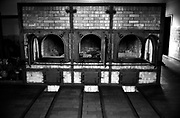 """The ovens in the crematorium<br />Buchenwald; literallybeech forest) was aNazi concentration campestablished onEttersberghill nearWeimar,Germany, in July 1937. On the main gate, the mottoJedem das Seine(English: """"To each his own""""), was inscribed. The SS interpreted this to mean the """"master race"""" had a right to humiliate and destroy others<br />It was one of the first and the largest of the concentration camps within Germany's1937 borders. Many actual or suspected communists were among the first internees.<br />Prisoners came from all over Europe and the Soviet Union—Jews,Polesand otherSlavs, the mentally ill and physically disabled, political prisoners,Romani people,Freemasons, and prisoners of war. There were also ordinary criminals and sexual """"deviants"""". All prisoners worked primarily as forced labour in local armaments factories. The insufficient food and poor conditions, as well as deliberate executions, led to 56,545 deaths at Buchenwald of the 280,000 prisoners who passed through the camp and its 139 subcamps.The camp gained notoriety when it was liberated by the United States Army in April 1945; Allied commanderDwight D. Eisenhowervisited one of itssubcamps.<br />From August 1945 to March 1950, the camp was used by the Soviet occupation authorities as an internment camp,NKVD special camp Nr. 2, where 28,455 prisoners were held and 7,113 of whom died. Today the remains of Buchenwald serve as a memorial and permanent exhibition and museum."""