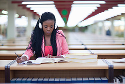 Female student studying in library (Credit Image: © Image Source/Albert Van Rosendaa/Image Source/ZUMAPRESS.com)