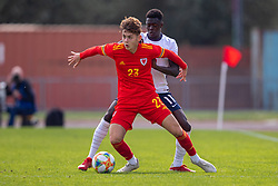 NEWPORT, WALES - Friday, September 3, 2021: Wales' Mathaeus Roberts (L) and England's Michael Olakigbe during an International Friendly Challenge match between Wales Under-18's and England Under-18's at Spytty Park. (Pic by David Rawcliffe/Propaganda)
