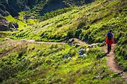 Hiker on the Cavern Point Trail at Scorpion Ranch, Santa Cruz island, Channel Islands National Park, California USA