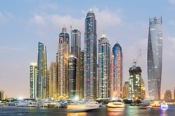 Skyline at dusk of skyscrapers in Marina district in Dubai United Arab Emirates