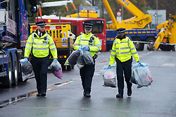 ©Licensed to London News Pictures 01/11/2019.<br /> Orpington,UK. Police officers walk away from the scene with evidence bags full. One person is dead and 15 others have been injured in a crash between two buses and a car last night in Orpington, South East London. A man has been arrested for dangerous driving. Police are still on scene and a cordon is in place. Photo credit: Grant Falvey/LNP