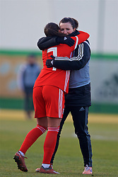 ZENICA, BOSNIA AND HERZEGOVINA - Tuesday, November 28, 2017: Wales' Natasha Harding and Helen Ward celebrate after the 1-0 victory over Bosnia and Herzegovina during the FIFA Women's World Cup 2019 Qualifying Round Group 1 match between Bosnia and Herzegovina and Wales at the FF BH Football Training Centre. (Pic by David Rawcliffe/Propaganda)