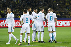 (L-R) Cristiano Ronaldo of Real Madrid, Daniel Carvajal of Real Madrid, Raphael Varane of Real Madrid, Casemiro of Real Madrid, Sergio Ramos of Real Madrid, referee Bjorn Kuipers, Toni Kroos of Real Madrid during the UEFA Champions League group H match between Borussia Dortmund and Real Madrid on September 26, 2017 at the Signal Iduna Park stadium in Dortmund, Germany.