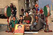 From coverage of revisit to Material World Project family in Bhutan, 2001. Nalim and Namgay's family, with whatever new possessions they have acquired since the shooting of the photograph of the family with all of its possessions for the 1994 book Material World: A Global Family Portrait.