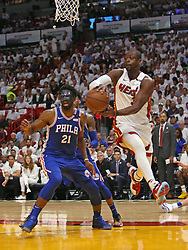 April 19, 2018 - Miami, FL, USA - The Miami Heat's Dwyane Wade, right, passes the ball against the Philadelphia 76ers' Joel Embiid during the first quarter in Game 3 of a first-round NBA playoff series at AmericanAirlines Arena in Miami on Thursday, April 19, 2018. (Credit Image: © David Santiago/TNS via ZUMA Wire)