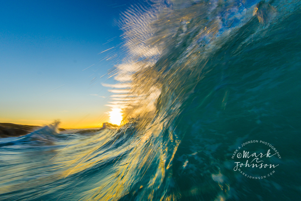 Breaking wave at sunset off the Queensland Coast of Australia