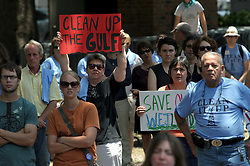 08 May 2010. New Orleans, Louisiana, USA. <br /> Protesters listen to Allison Chin, President of the Sierra Club at a rally to demonstrate against British Petroleum's massive devastating oil leak in the Gulf of Mexico.<br /> Photo; Charlie Varley/varleypix.com