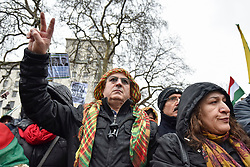 © Licensed to London News Pictures. 27/01/2018. LONDON, UK.  Protesters gather in front of Downing Street as thousands of Kurdish people march from outside the BBC's Headquarters in Portland Place to Downing Street to protest against Turkey's military invasion of the city of Afrin in Northern Syria, a predominantly Kurdish city.  Protesters called for the British public to show solidarity with the people of Afrin and for the UK to demand that Turkey pull back its forces.  Photo credit: Stephen Chung/LNP