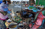 Low-tide temporary noodel stir-fry and wok restaurant at the fish-collecting point, Shi Ma Jiao harbour, Guangdong province, China