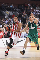ATHENS, April 19, 2018  Brian Roberts (L) of Olympiacos Piraeus competes with Kevin Pangos of Zalgiris Kaunas during the first playoff of the basketball Euroleague between Olympiacos Piraeus and Zalgiris Kaunas at the Peace and Friendship Stadium in Athens, Greece, on April 18, 2018. (Credit Image: © Lefteris Partsalis/Xinhua via ZUMA Wire)
