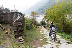 Biltwell's Patrick Lies riding up a stone trail on a Royal Enfield Himalayan in Motorcycle Sherpa's Ride to the Heavens motorcycle adventure in the Himalayas of Nepal. On the fourth day of riding, we went from Kalopani to Muktinath. Thursday, November 7, 2019. Photography ©2019 Michael Lichter.