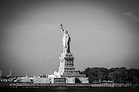 The Statue of Liberty as seen from the Staten Island Ferry in black and white.