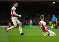 Football - 2018 / 2019 Premier League - Arsenal vs. Newcastle United<br /> <br /> Aaron Ramsey (Arsenal FC) slides on his knees in front of the Arsenal fans after he gives his team the lead at The Emirates.<br /> <br /> COLORSPORT/DANIEL BEARHAM