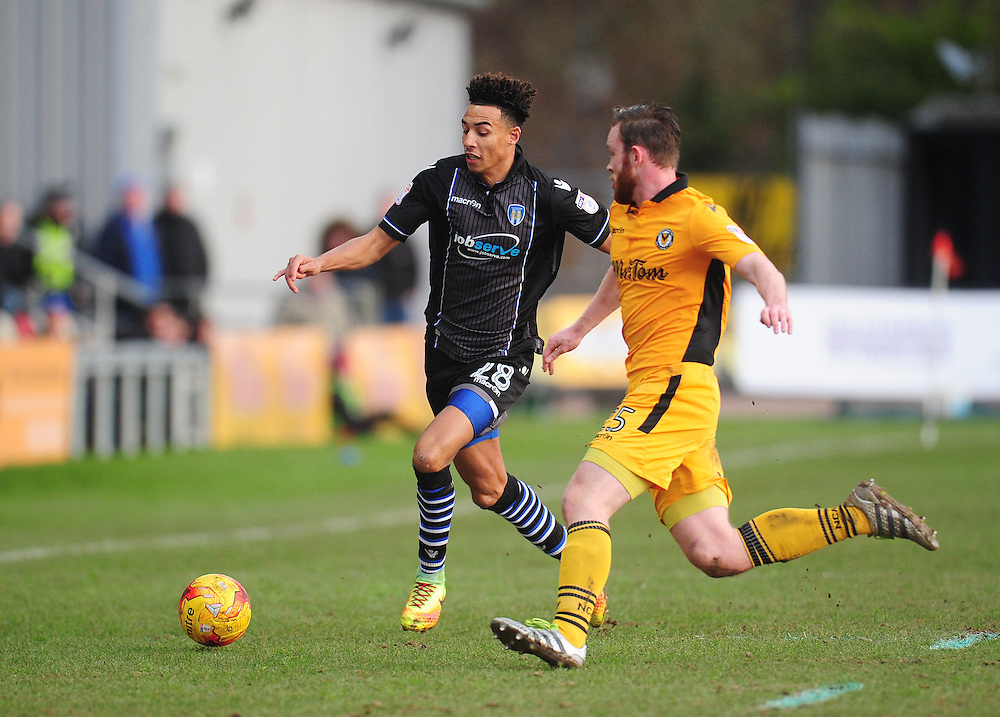 Colchester United's Kurtis Guthrie under pressure from Newport County's Mark O'Brien<br /> <br /> Photographer Kevin Barnes/CameraSport<br /> <br /> The EFL Sky Bet League Two - Newport County v Colchester United - Saturday 14th January 2017 - Rodney Parade - Newport<br /> <br /> World Copyright © 2017 CameraSport. All rights reserved. 43 Linden Ave. Countesthorpe. Leicester. England. LE8 5PG - Tel: +44 (0) 116 277 4147 - admin@camerasport.com - www.camerasport.com